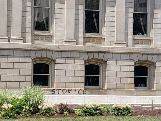 STOP ICE graffiti on the Michigan Capitol