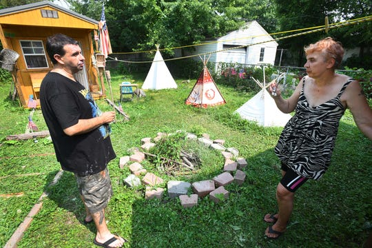 """Robert Mounts and Mary Pustelak have built """"The Outpost,"""" a Native American-inspired village in their Detroit backyard."""