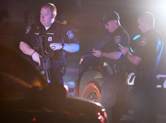 Law enforcement officials block off the area on St. Margaret Street, north of 13 Mile, in St. Clair Shores late Thursday night.
