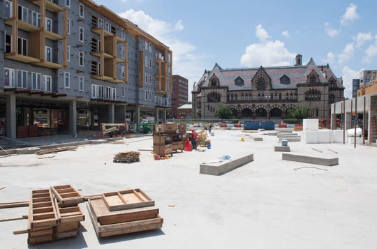Construction of Post House continues in front of the Old Post Office off Second Street in Downtown Evansville Wednesday, July 5, 2019.