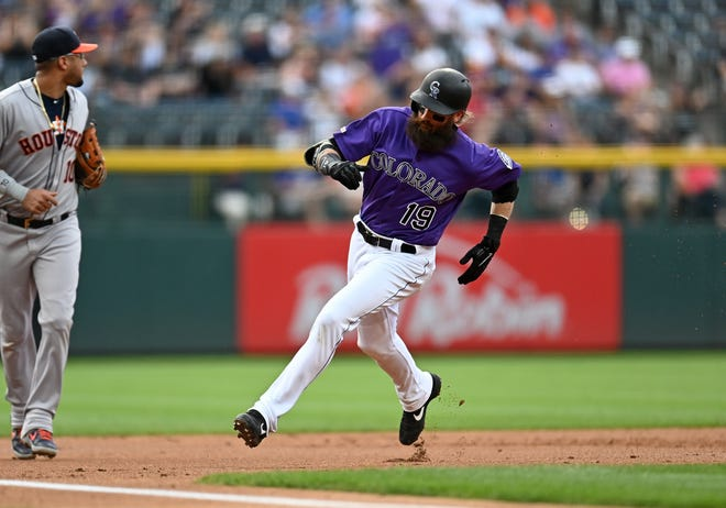 All-star outfielder Charlie Blackmon of the Colorado Rockies rounds third base and heads for home plate during a July 3 game against the Houston Astros at Coors Field in Denver. Blackmon and the Rockies wrap up the first half of the season with games at Arizona at 8:10 p.m. Saturday and 2:10 p.m. Sunday.