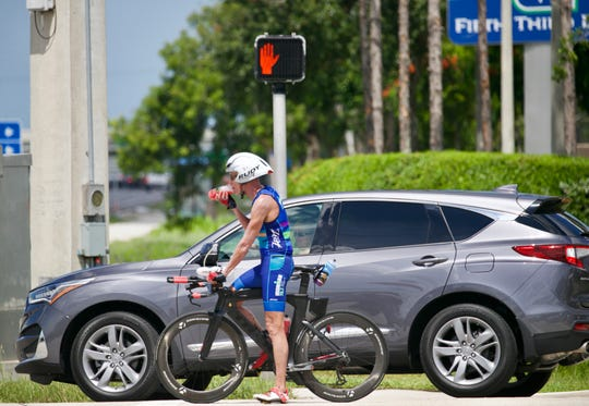 Cyclists on Treeline Avenue cross Daniels Parkway on Friday, July 5, 2019, in Fort Myers. Officials are working on a way to help cyclists safely make left turns at the intersection.