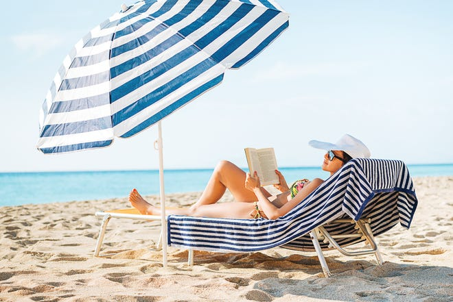 It's easy to lose yourself in a good book while relaxing on the beach.