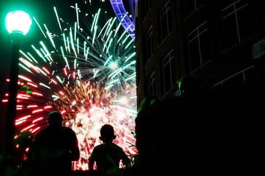 People watch fireworks during the Red, White & Blue Festival in downtown Greenville Thursday, July 4, 2019.