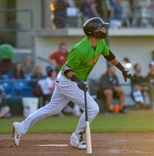 Great Falls Voyagers batter Sam Abbott, who homered against Rocky Mountain Sunday in Colorado Springs, watches the ball he hit sail into the outfield during a recent game against the Billings Mustangs.