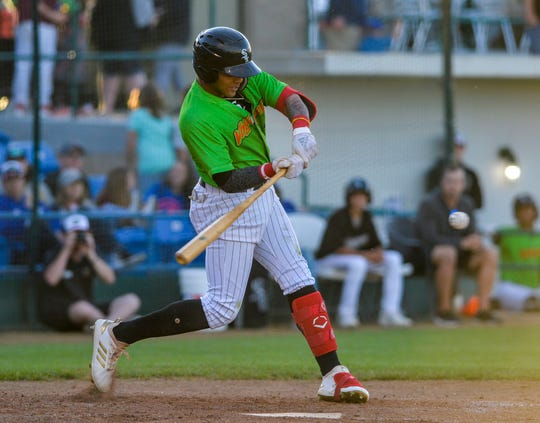Great Falls Voyagers batter Lency Delgado swings at a pitch during a game earlier this month against the Billings Mustangs at Centene Stadium.