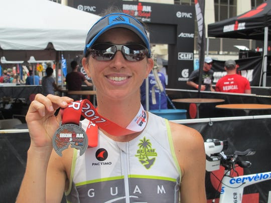 Kristi Woesner celebrates after completing the Ironman 70.3 Raleigh on June 6, 2017.