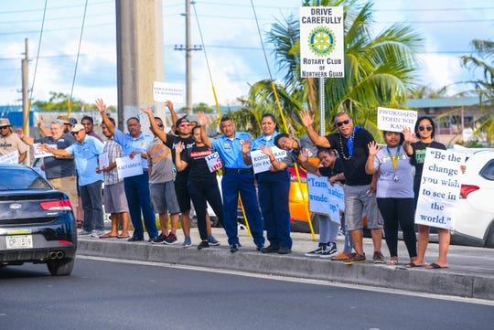 Guam Police Department officers, University of Guam's 4-H Club Micronesia Resource Center members, groups representing various Micronesia island nations and other supporters gather together to raise awareness of community unity during a wave along Marine Corps Drive in Dededo on Wednesday, July 3, 2019.