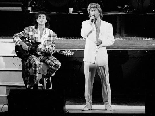 Wham! (Andrew Ridgeley, left, and George Michael) perform in 1985.