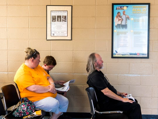 A Real ID informational sign hangs in the waiting area of the Strawberry Plains Driver Services Center on Friday, July 5, 2019.