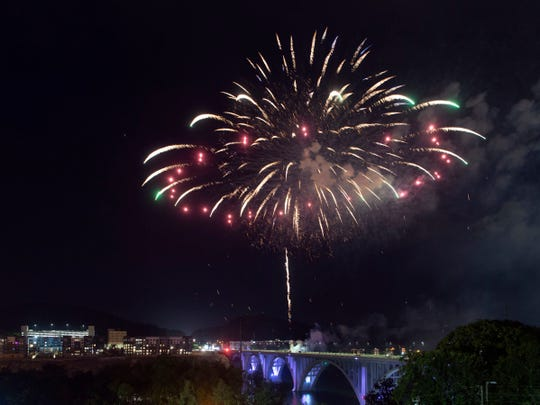 Fireworks explode over the Henley Bridge during Knoxville's Independence Day celebration, Festival on the Fourth at World's Fair Park on Thursday, July 4, 2019.
