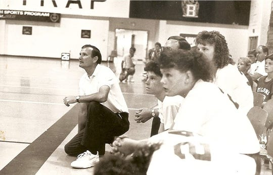 Kenneth Jolly is shown here coaching Kellie Harper's 11-under AAU basketball team, which won a national championship
