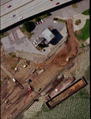 Riverfront Park, cranes driving pilings.  I-64 at top of photo. July 26, 1995. July 26, 1995.