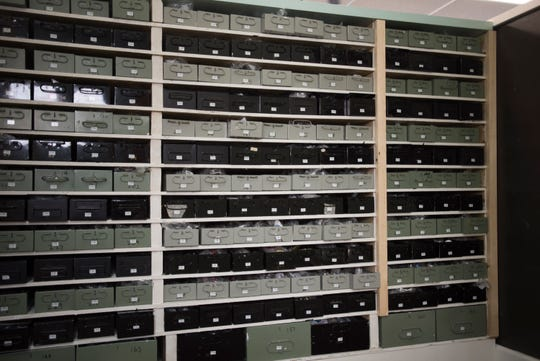 Repurposed safety deposit boxes used to organize hardware.