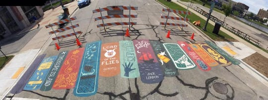 An artful crosswalk in downtown Manitowoc on the street between the Briess parking lot and the library.