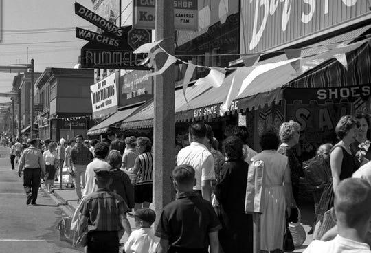 Crowds find bargains at a Krazy Daze long ago.