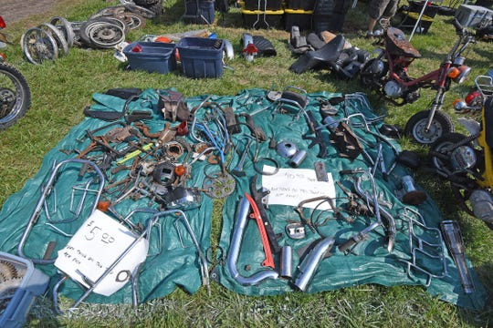 Motorcycle parts for sale Friday at the swap meet during AMA Vintage Motorcycle Days the Mid-Ohio Sports Car Course.