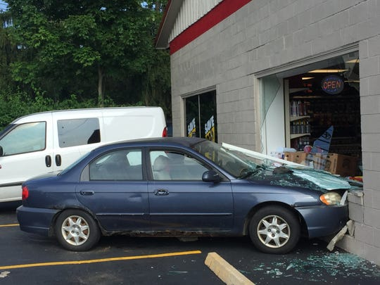 A blue Kia struck Advance Auto Parts on Friday morning. The driver fled the scene but was later arrested.