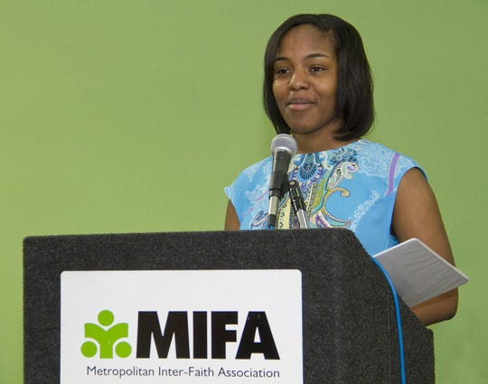 Central High School student Clarissa Williams delivers the keynote speech at MIFA's recent Day of Reflection and Service.