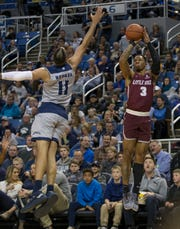 Little Rock guard Rayjon Tucker (3) shoots over Nevada's Cody Martin (11) during the first half of an NCAA college basketball game in Reno, Nev., Friday, Nov. 16, 2018. (AP Photo/Tom R. Smedes)
