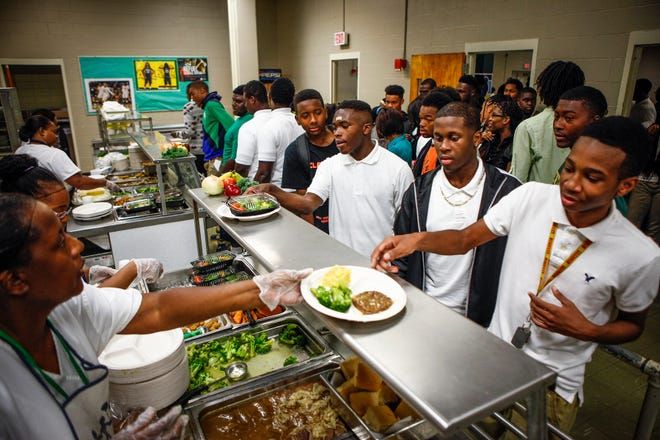 September 4, 2014 - Students make their way through the cafeteria line as the first of three lunch periods gets underway at Central High School.