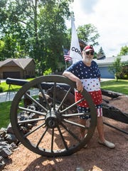 Greenfield resident Frank Markel stands in his front yard with three of his Civil War-era cannons on Thursday, July 4, 2019. Markel has been battling noise complaints and city fines regarding his annual tradition of firing the cannons in honor of Independence Day.