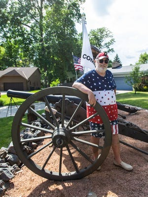 Greenfield resident Frank Markel stands in his front yard with three of his Civil War-era cannons on Thursday, July 4, 2019. Markel has been battling noise complaints and city fines regarding his annual tradition of firing the cannons in honor of Independence Day. Markel said he will not be firing the cannons this year due to the coronavirus pandemic.