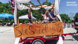Josh Larson of Franklin had a surprise proposal for his girlfriend Amber Riley as he rolled up on a float in the Franklin Civic Celebration Parade on Thursday, July 4, 2019.