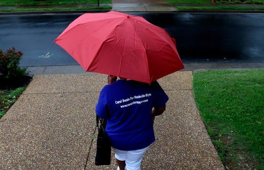 Nashville mayoral candidate Carol Swain campaigns in her neighborhood on Saturday, June 22, 2019, in Nashville, Tenn.