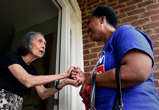 Nashville mayoral candidate Carol Swain talks with Pat Wynn as she campaigns in her neighborhood on Saturday, June 22, 2019, in Nashville, Tenn.