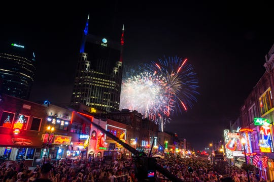 A crowd watches Fourth of July fireworks on Broadway in 2019. The 2020 Independence Day block party and concert in downtown Nashville has been canceled, with a fireworks show set to air in local TV instead.