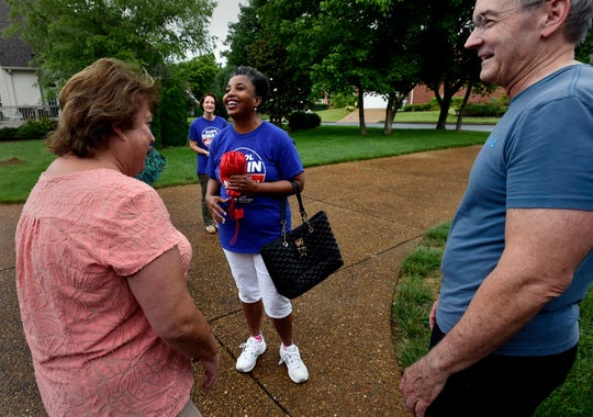 Nashville mayoral candidate Carol Swain talks with Dee Morrison, left, as she campaigns in her neighborhood on Saturday, June 22, 2019, in Nashville, Tenn.