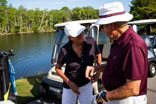 From left, Alice Taylor, 88, laughs with Paul Donald, 90, while golfing together at Vi at Bentley Village in North Naples on on Wednesday, July 5, 2019.