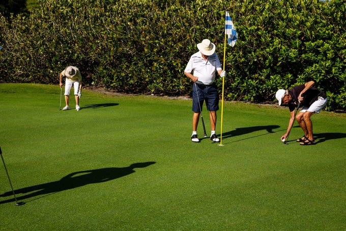 From left, Peg Wilmott, Dr. Jerry Weis, and Alice Taylor putt on the green at Vi at Bentley Village in North Naples on Wednesday, July 5, 2019. In the group, many senior golfers have recorded multiple holes-in-one at the course in the retirement community.