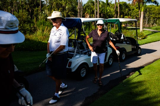 Alice Taylor, 88, stands near her golf cart while golfing with friends at Vi at Bentley Village in North Naples on Wednesday, July 5, 2019. Taylor has gotten 18 holes in at Bentley.