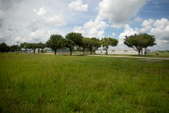 An open undeveloped space along Airpark Boulevard is pictured, Friday, July 5, 2019, across the street from the Immokalee Regional Airport.