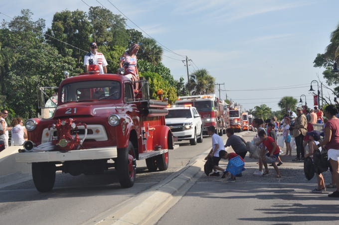 Most of the trucks and floats in the parade tossed out candy which children scrambled to collect. The 61st annual event on Thursday, July 4, 2019 took place on Old 41 Road in downtown Bonita Springs.