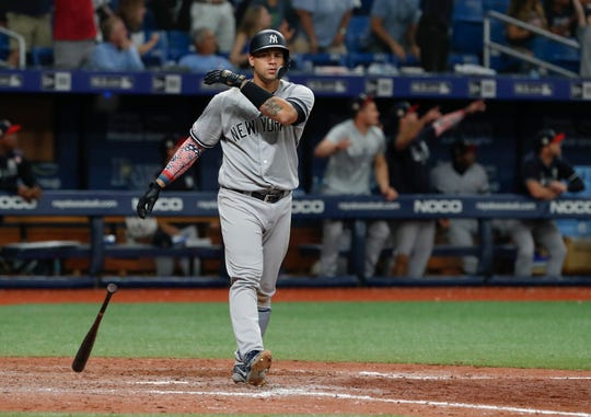 New York Yankees' Gary Sanchez drops his bat after hitting a three-run home run against the Tampa Bay Rays during the 10th inning of a baseball game Thursday, July 4, 2019, in St. Petersburg, Fla.