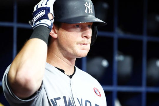 Jul 4, 2019; St. Petersburg, FL, USA; New York Yankees third baseman DJ LeMahieu (26) in the dugout as he gets ready to bat in the first inning against the Tampa Bay Rays at Tropicana Field.