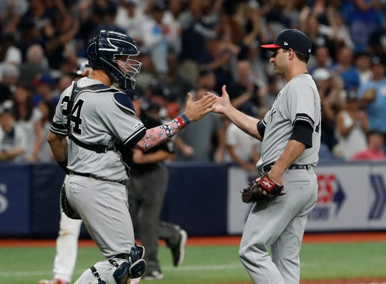 New York Yankees pitcher David Hale celebrates with catcher Gary Sanchez after the Yankees defeated the Tampa Bay Rays 8-4 during a baseball game Thursday, July 4, 2019, in St. Petersburg, Fla.