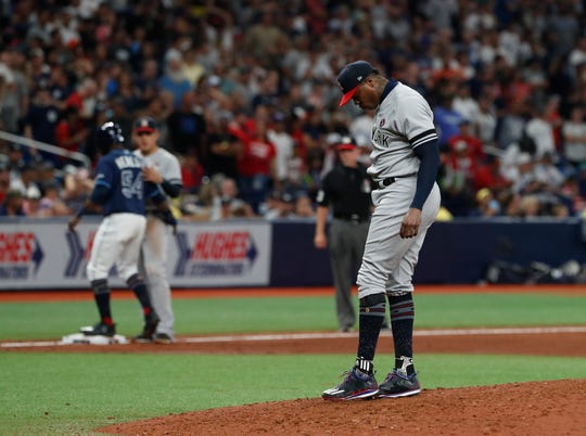 New York Yankees pitcher Aroldis Chapman reacts during the ninth inning of a baseball game against the Tampa Bay Rays Thursday, July 4, 2019, in St. Petersburg, Fla.