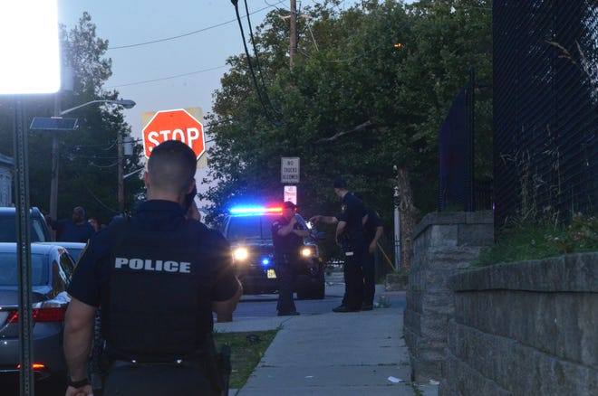 Paterson police investigate after a man was beaten unconscious outside a local bar.