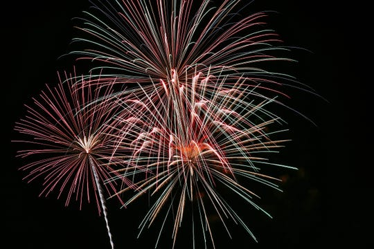 Fireworks are seen from the Aggie Memorial Stadium at the City of Las Cruces and New Mexico State Universities annual 4th of July Celebration on NMSU campus on Thursday, June 4, 2019.