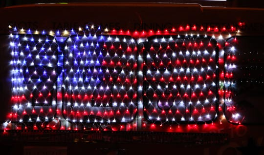 A flag made of lights adorns the side of a Northern Edge Casino van entered in the July 4 Farmington Rotary Electric Light Parade.