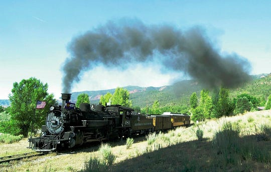 In this July 13, 2002 file photo, a Durango & Silverton Narrow Gauge Railroad train begins the climb out of the Animas Valley north of Durango, Colo.