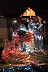 A simulated flame is featured on one of the floats in the July 4 Farmington Rotary Parade of Lights.