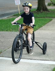 Colin Schrader, 6, rides his Fat Wheel bicycle near his Birmingham home on July 5, 2019. Schrader, who has a mild form of cerebal palsy, received the bike from Beaumont Hospital so he could keep active and keep his balance as he makes his way around the neighborhood.