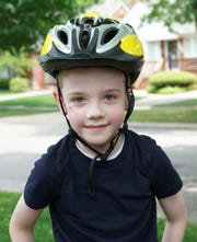After receiving a Fat Wheel bike from Beaumont, Colin Schrader, 6, is ready for a summer of safe fun in his Birmingham neighborhood.
