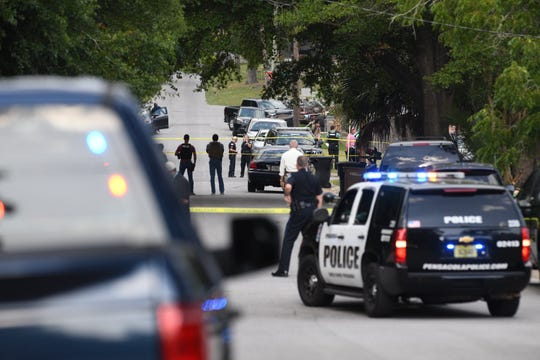 Pensacola police respond July 5 to the scene of an officer-involved shooting near C and Brainerd streets.