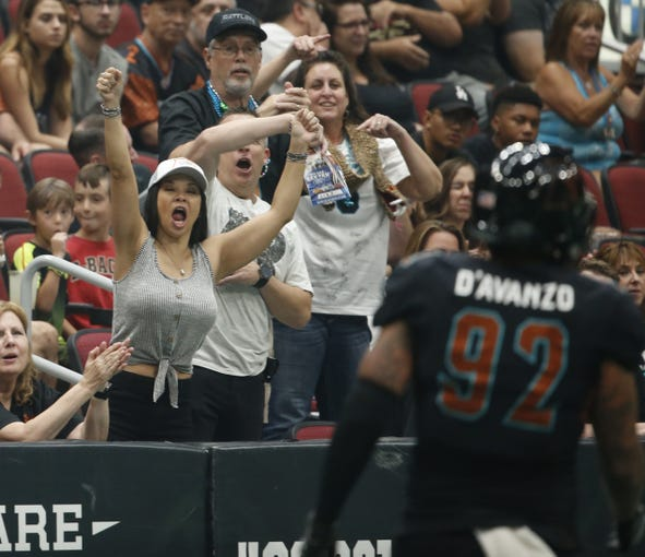 Rattlers fans celebrate a touchdown against the Danger during the Conference Championship at Gila River Arena in Glendale, Ariz. on June 29, 2019.